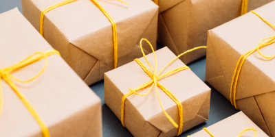 Boxes wrapped in brown paper with yellow ribbons