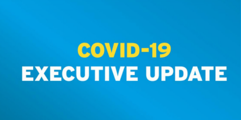 Covid 19 Executive update written on blue background